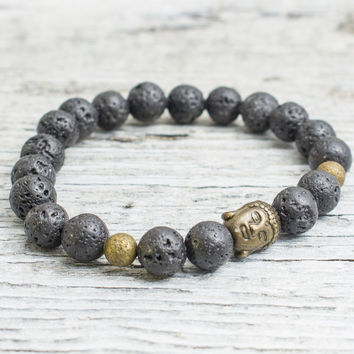 Black lava stone beaded stretchy bracelet with bronze Buddha bead, mens bracelet, womens bracelet