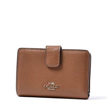 COACH Crossgrain Leather Medium Corner Zip Wallet Clutch (Saddle)
