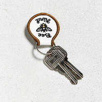 Beholder Bee Kind Keychain | Urban Outfitters
