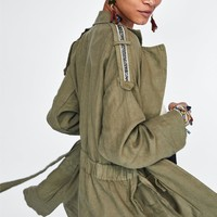 LINEN COAT WITH APPLIQUÉ DETAILS