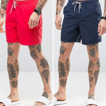 ASOS Swim Shorts 2 Pack In Red And Navy In Mid Length SAVE at asos.com