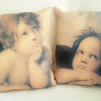 "Cushions / pillows ""Raphael 's angels"" or ""Cherubim"" painted by Raphael, printed on cotton canvas. Cushion cover, insert sold apart."