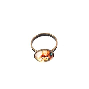 Inspired by Vintage Matchbox Labels, Botanical prints, Victorian and other beautiful images, these rings are a super fun way to accessorize! All rings are Brass or Copper finished, and adjustable. The Ring top is 12mm across.