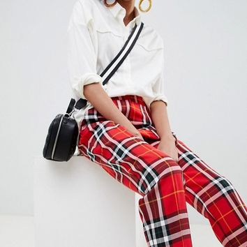 ASOS DESIGN ultimate red and black check ankle grazer trousers at asos.com