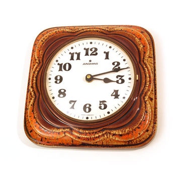 Retro warm brown / orange earthenware / ceramic wall clock. Junghans, Germany