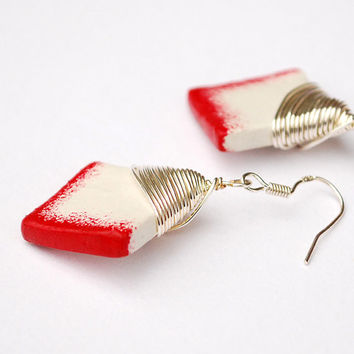 Bright red and white earrings. Handmade clay jewelry with silver coloured wire wrap and fish hook earwires. Lightweight & modern.