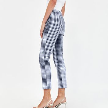 CHECKED TROUSERS WITH RUFFLES