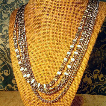 Four strand silver chain Sarah Coventry necklace. In very good condition.