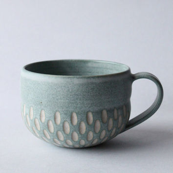 incised turquoise mug
