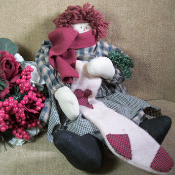 Raggedy Style Doll with Red Yarn Hair Soft Sculpture Muslin Girl Holding Christmas Stocking Winter Home Decoration