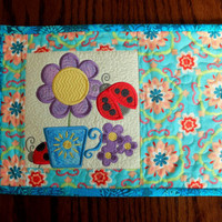 Patchwork quilted and embroidered mug rug, embroidered flowerpot and ladybirds.  Aqua/turquoise, purple, floral snack mat, placemat