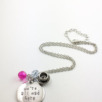 "Alice in wonderland theme hand stamped ""we're all mad here"" necklace"