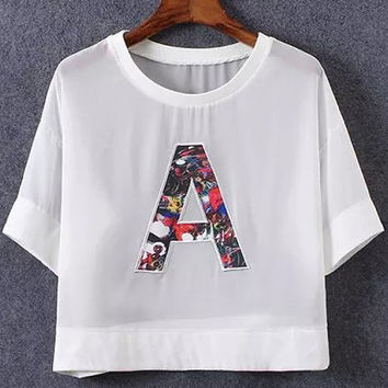 A Graphic Patched White Sheer Mesh Crop Top