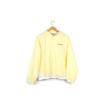 90s REEBOK windbreaker track jacket / vintage 1990s / pastel yellow / classic / retro / medium - large