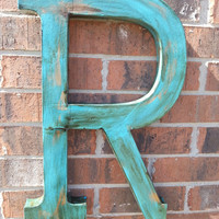 Decorative extra large  distressed letter R. With a rustic stain finish.