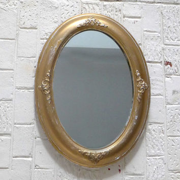 Vintage mid century distressed gold oval wood and plaster mirror