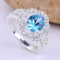 Blue Oval Topaz CZ Ring