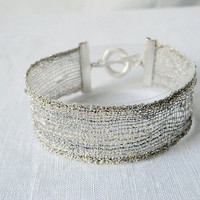 bracelet, handmade bobbin lace out of yarn, silver, silver coated fastener, klöppeln, dentelle, kant, lace, handmade, inana no1045