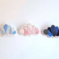 Embroidered brooch set of clouds sunny and rainy day colors hand embroidered in blues and pinks on cream muslin An Astrid Endeavor