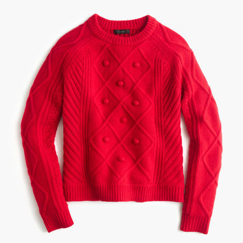 Italian cashmere cable sweater with pom-poms