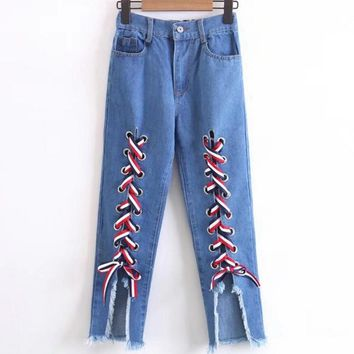 Stylish Front Bandage Rip Hole Denim Jeans