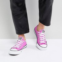 Converse Chuck Taylor All Star Ox Trainers In Magenta at asos.com