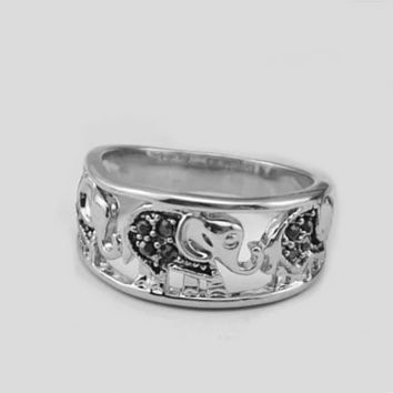 Trunks And Tails Playful Elephants Ring