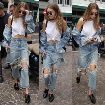 Washed old hole denim false two skirt irregular nine points jeans women