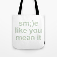 Smile like you mean it Tote Bag by g-man