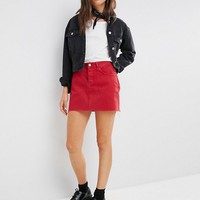 ASOS Denim Mini Skirt With Raw Hem in Washed Red at asos.com