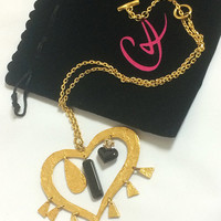 Vintage Christian Lacroix golden outlined large heart pendant top necklace with dangling charms and crystal stones. Perfect gift jewelry.