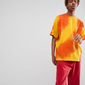 ASOS DESIGN oversized longline t-shirt with diagonal tie dye in yellow at asos.com
