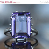 LOVE ON SALE Sterling silver ring with an unfoiled 14x10mm Swarovski step-cut crystal in tanzanite