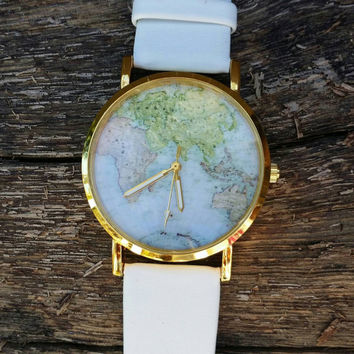WHITE world map watch.     code 625 ships March 18th. Do not order if you need it sooner