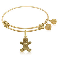 Expandable Bangle in Yellow Tone Brass with Gingerbread Man Symbol