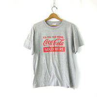 Vintage Coca Cola TShirt gray Tee 1990s Cotton Sporty pullover COED size Large The Real Thing Sold Here
