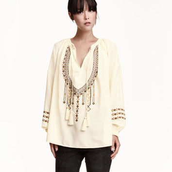 H&M Embroidered Blouse $59.99