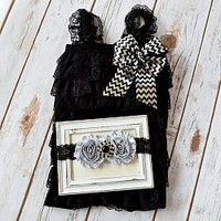 Baby girls black lace romper with stunning silver and black chevron bow with matching double shabby chic flower headband. Your Final Touch Hair Accessories