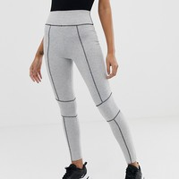 ASOS DESIGN legging with contrast panels and deep waistband at asos.com