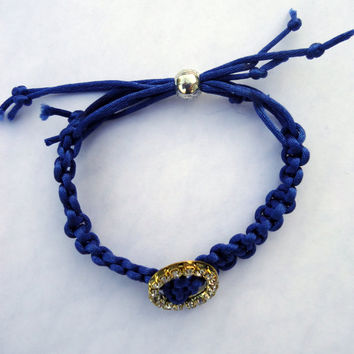 Macrame bracelet in royal blue silk cord with rhinestone slider bead and slding silver plated bead.
