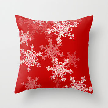 Red snowflakes Throw Pillow by Silvianna
