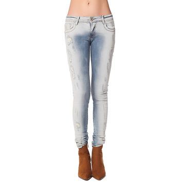 Light wash jeans with all over rips & distressing