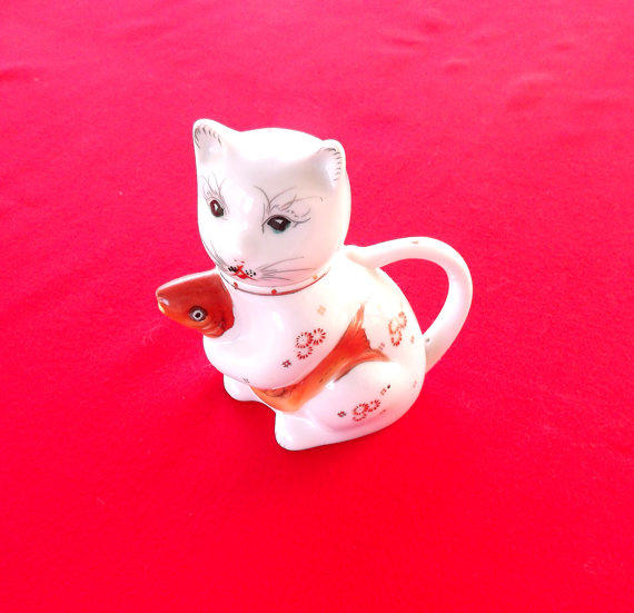 Cat Holding Cup With Tail