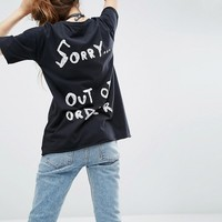 ASOS T-Shirt With Out Of Order Print In Washed Longline Fit at asos.com