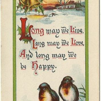 "Snowbirds sit in front of a Country Snow Scene Holly & Bells on this Antique Early 1900s Holiday Postcard ""Long may we live, Long may we ..."