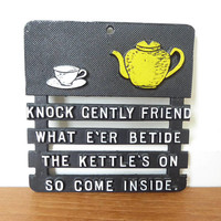 Knock Gently Friend the Kettle's On vintage cast metal trivet
