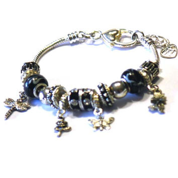 Flowers, Dragonfly and Butterly Charms Bracelet. A perfect gift idea for Teenagers, women or girls +3. Bracelet for a friend