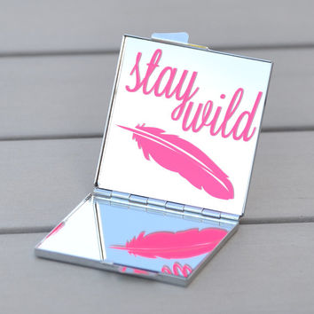 Neon pink Stay Wild feather compact mirror