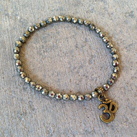 Confidence and Persistence, fine faceted Pyrite gemstone bracelet with Om charm
