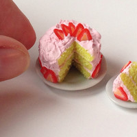 Miniature Pink Frosted Strawberry Cake with Slice